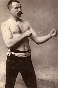John L. Sullivan was the last bare knuckle Heavyweight boxing Champion of the World, and first gloved boxing Heavyweight Champion of the World from 1882-1892. Was the first American athlete to win over one million dollars in prize money. Record of 40-1-2 (1) (34 KO), won over 450 amateur and exhibition bouts. The last bare knuckle world title fight ever was won by Sullivan by KO in the 75th round. Member of the Boxing Hall of Fame Inaugural Class.