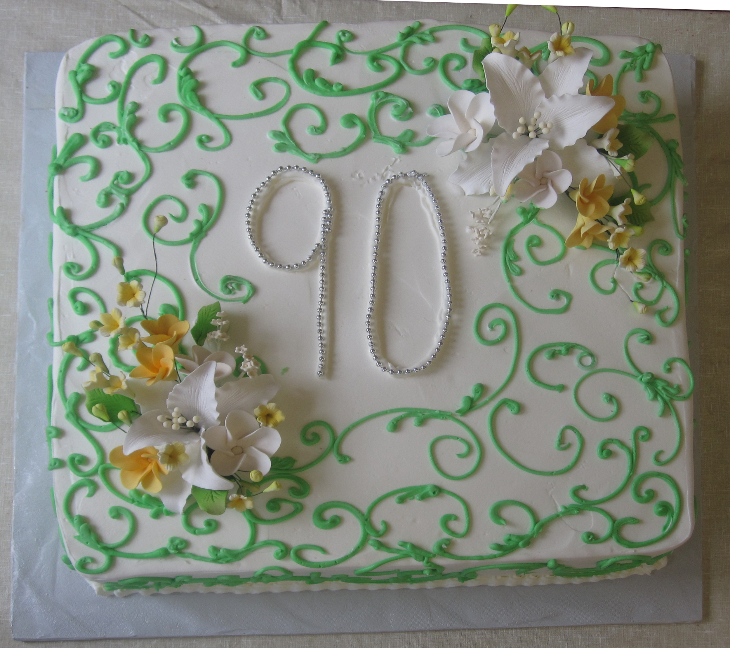 Swirls in green with 2 Gum Paste Bouquets & number