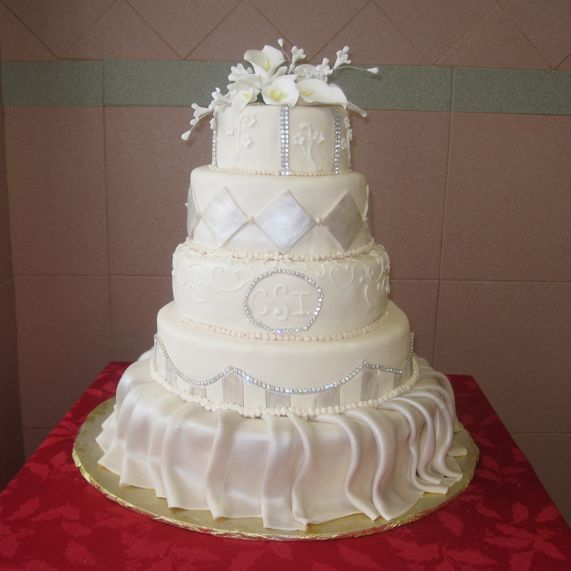 Ivory Rolled Fondant Skirted, Two Tone Arch Work, Monogram & Pearlized Cutouts
