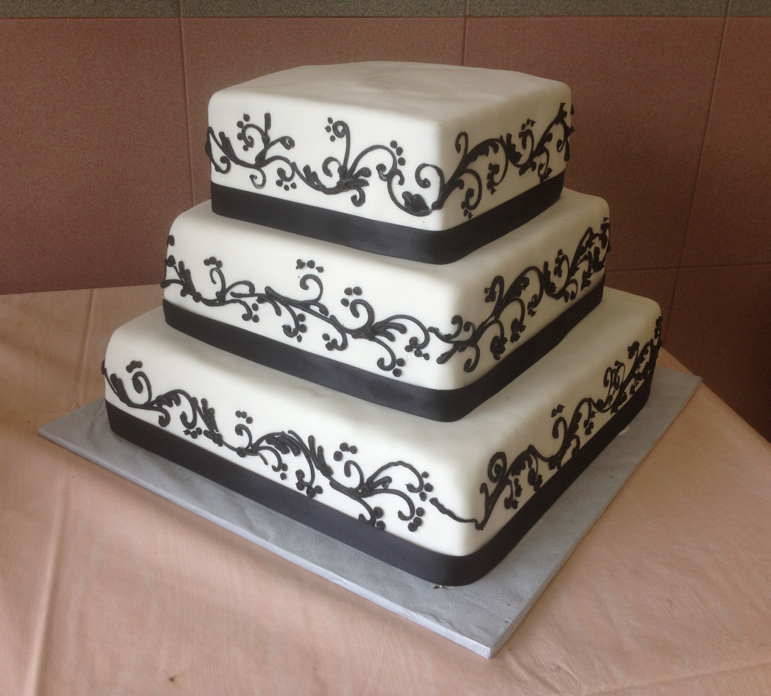 Rolled Fondant with Black Material Ribbon & Scrolls
