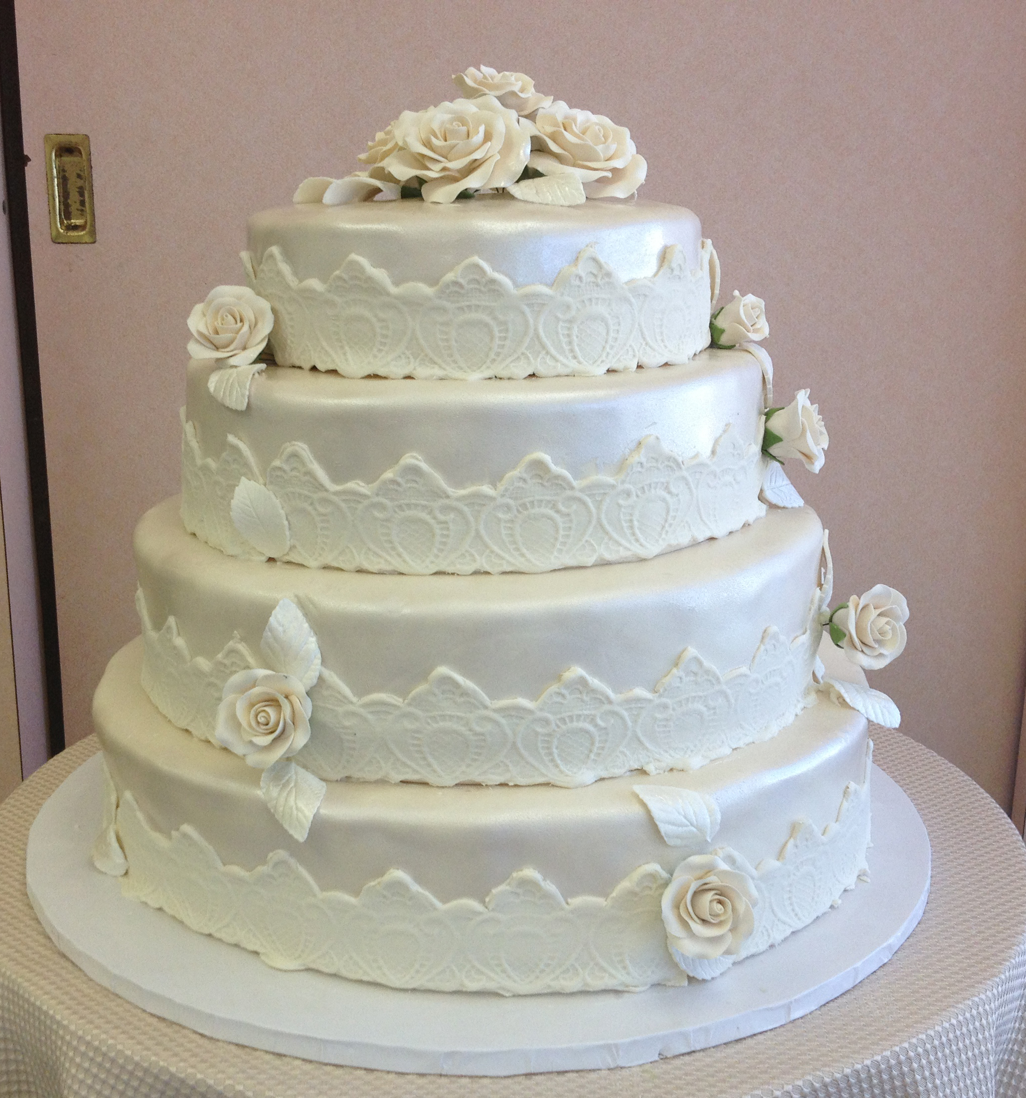 Ivory Rolled Fondant Pearlized with White Rolled Fondant Banding. Rolled Fondant Leaves & Roses