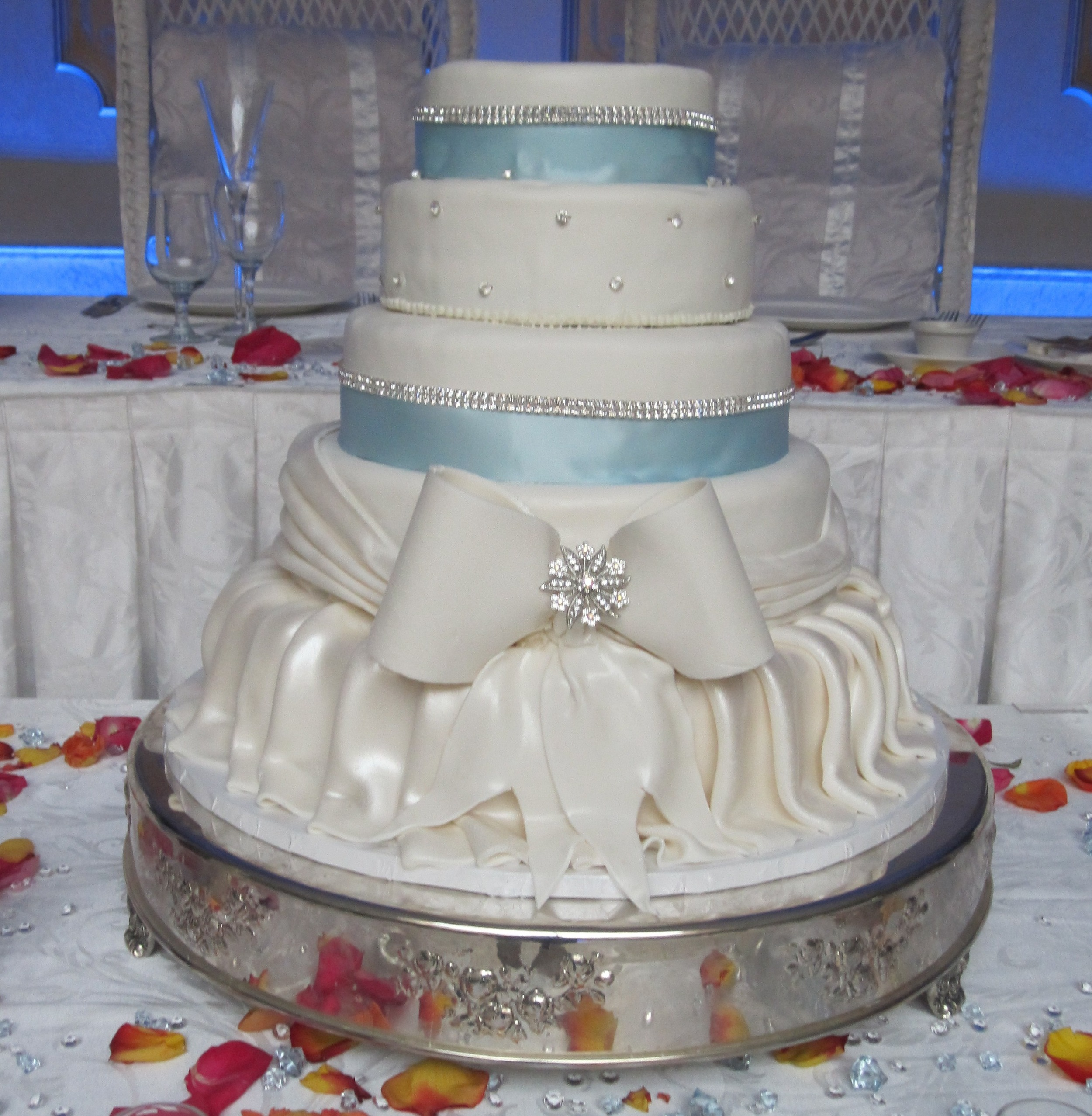 45 with Wrapped Rolled Fondant & Extra Large Bow. Material Ribbon & Crystals