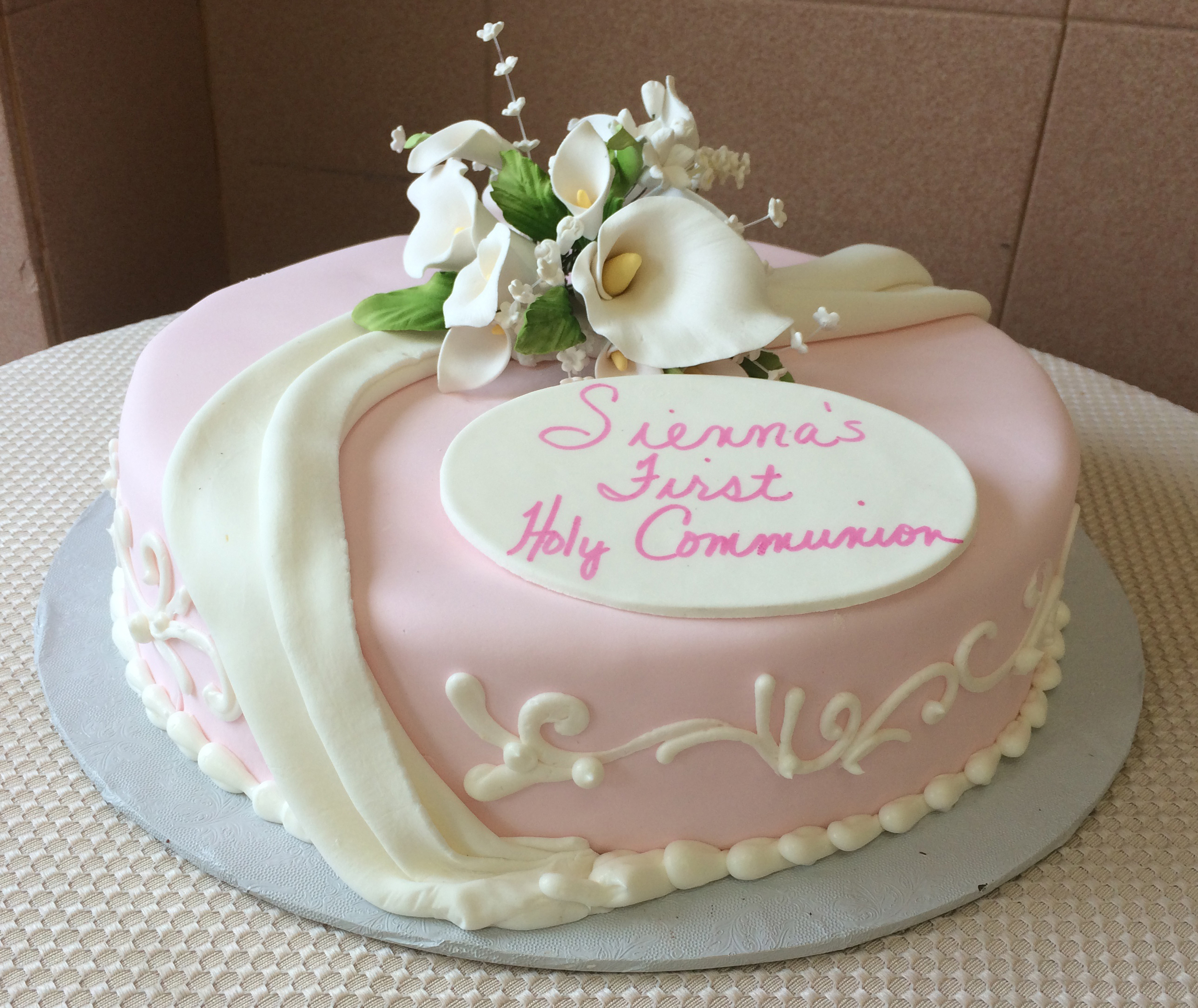 Pink Rolled Fondant, White Drapes & Calla Lilies
