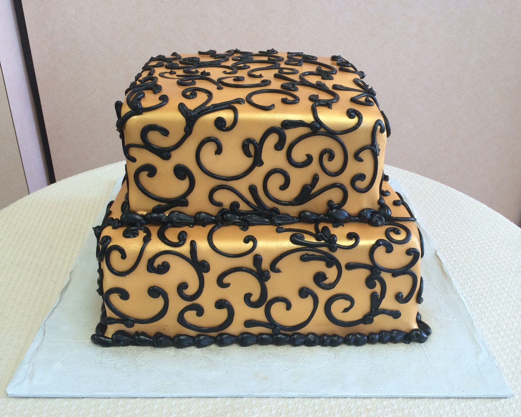 35 with Gold Rolled Fondant and Black Scrolls