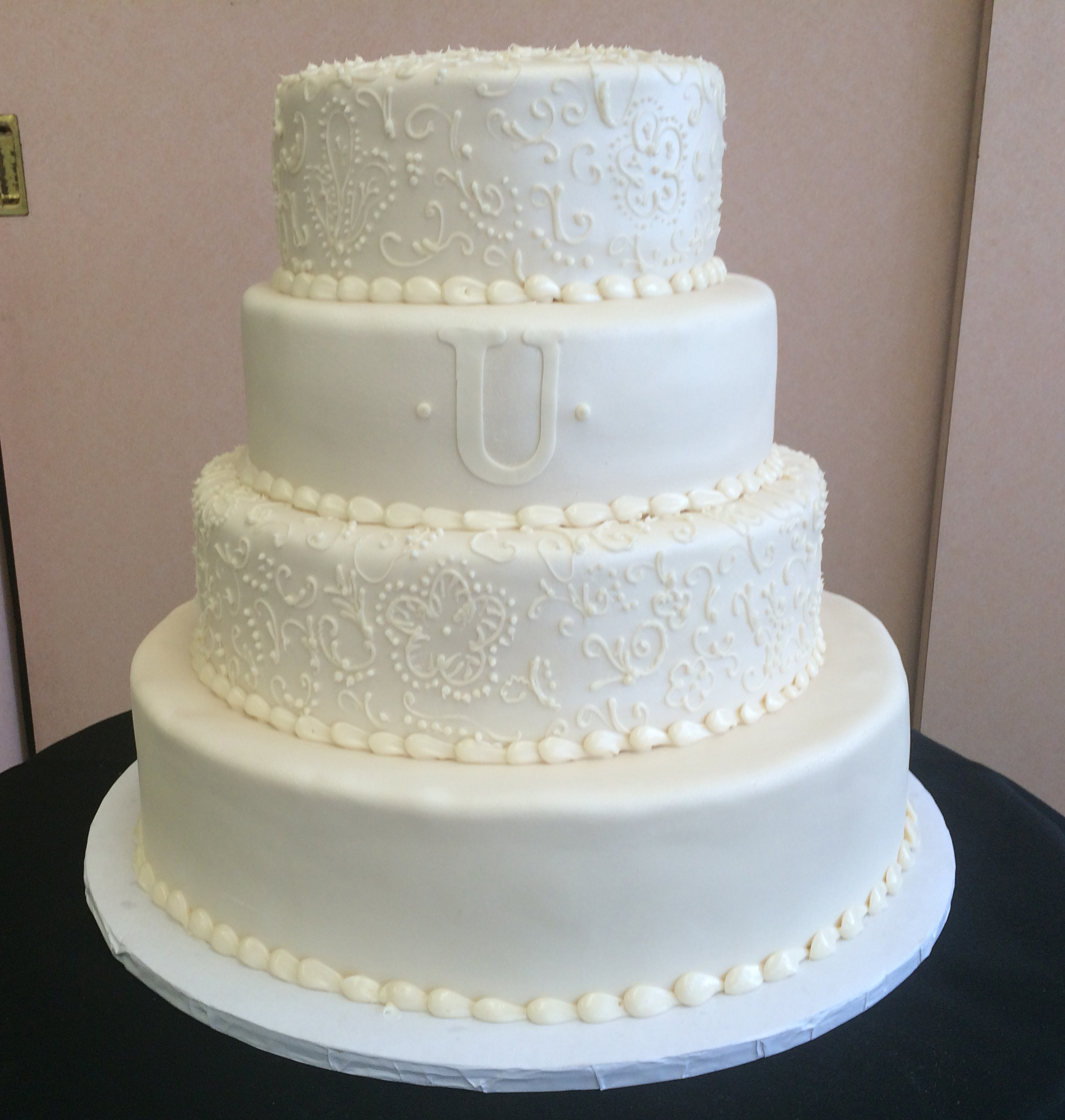Ivory Rolled Fondant pealized with henna patterened butter cream design. Single Monogram.jpg