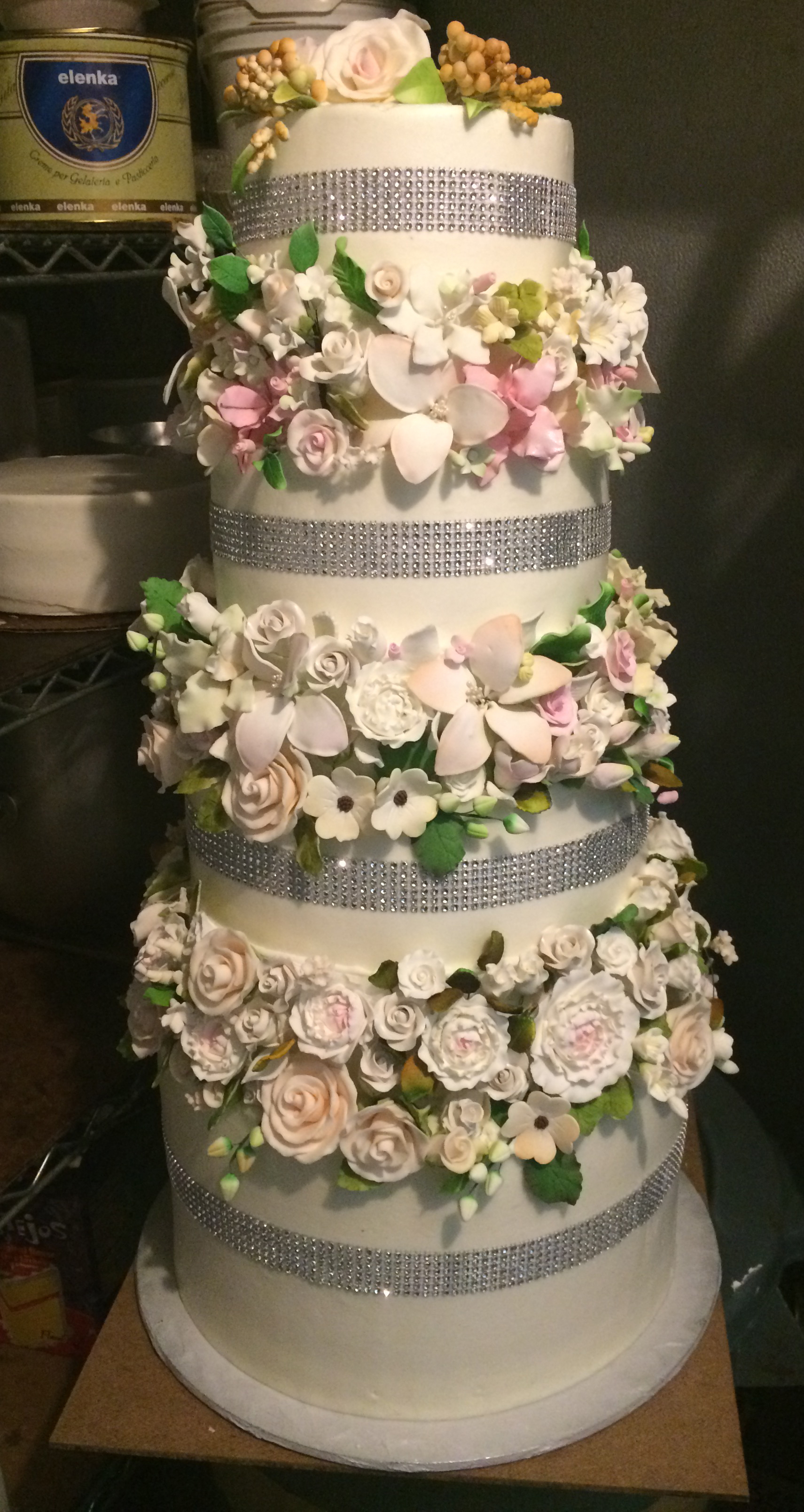 Butter Cream out Faux Crystals with 3-3 inch Rolled Fondant Flowers.jpg