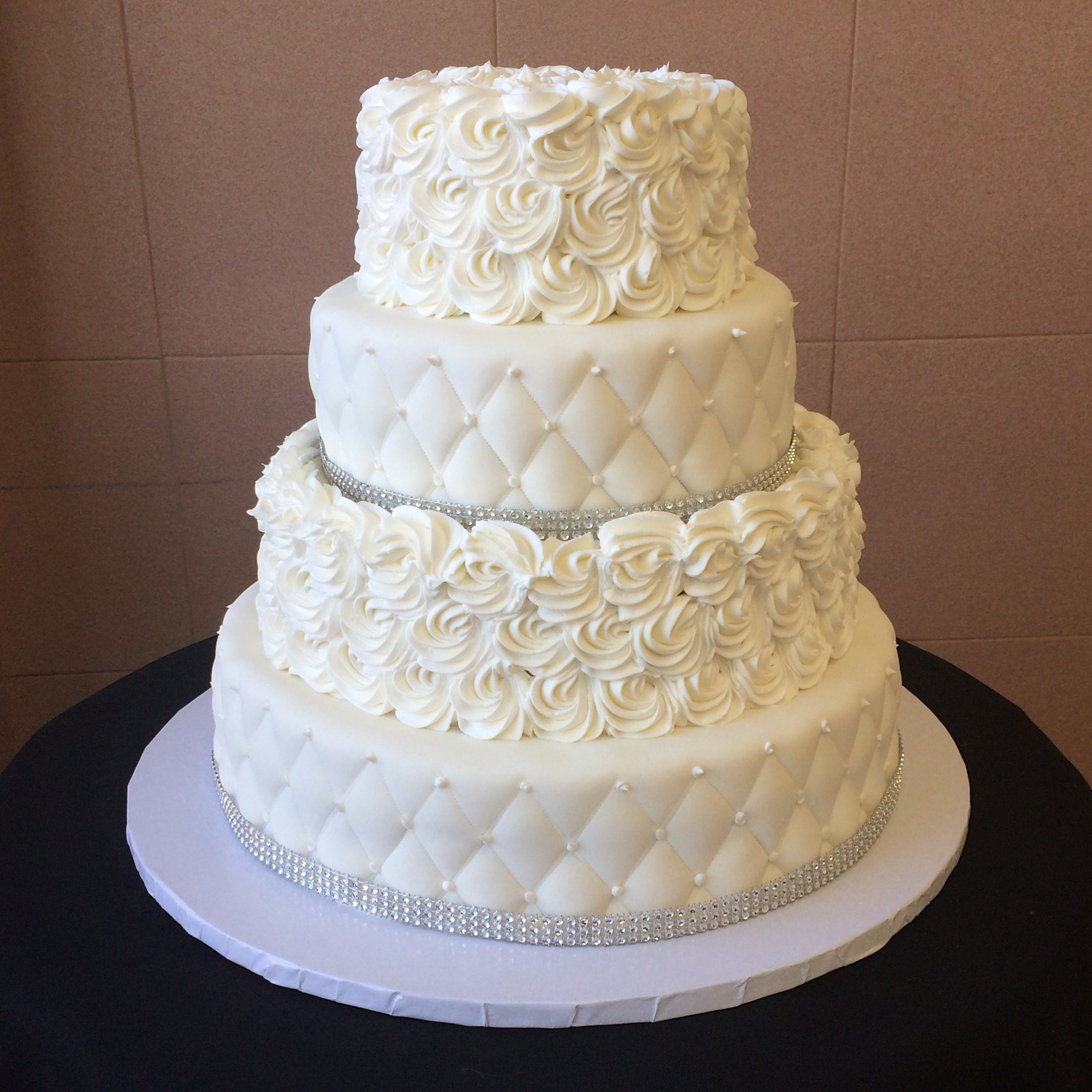 White Rolled Fondant Quilted with Faux Crystals. Alternating with Large Butter Cream Rosettes.jpg