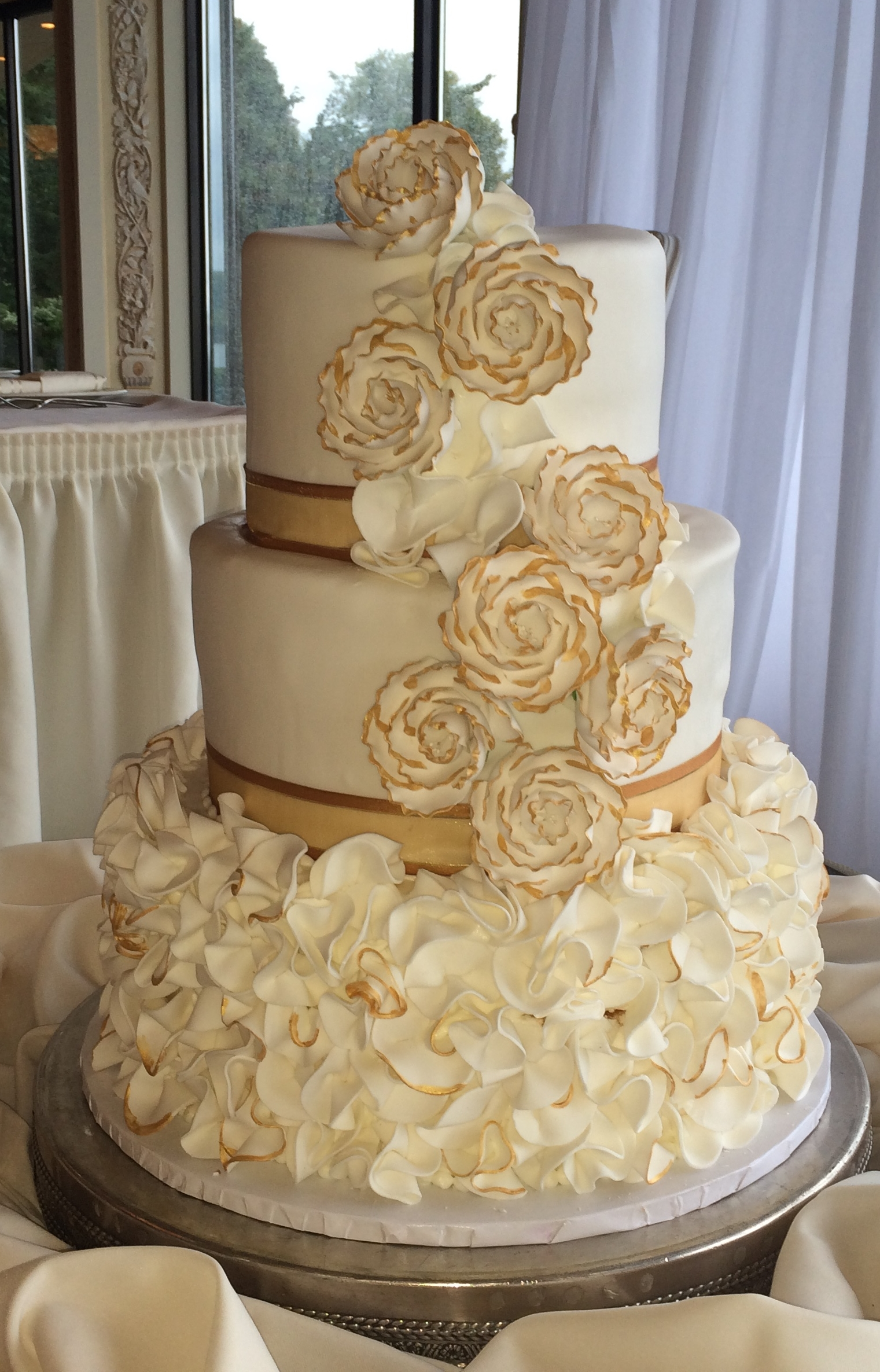 Double Tiered White Rolled Fondant Scrunches edging in gold. Cascading Roses edges in gold.jpeg