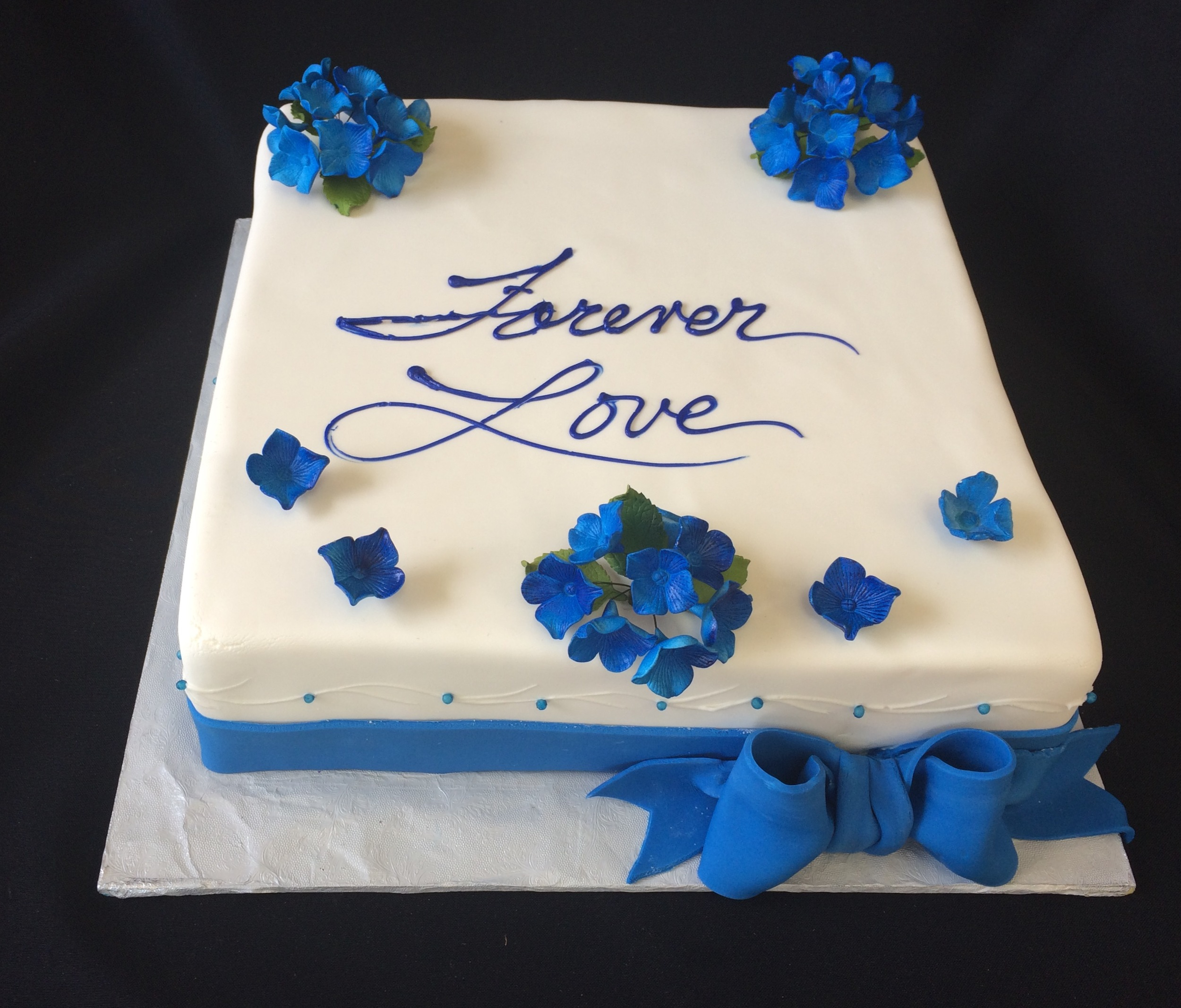 Rolled fondant w band bow. Airbrushed Hydrangeas .jpg