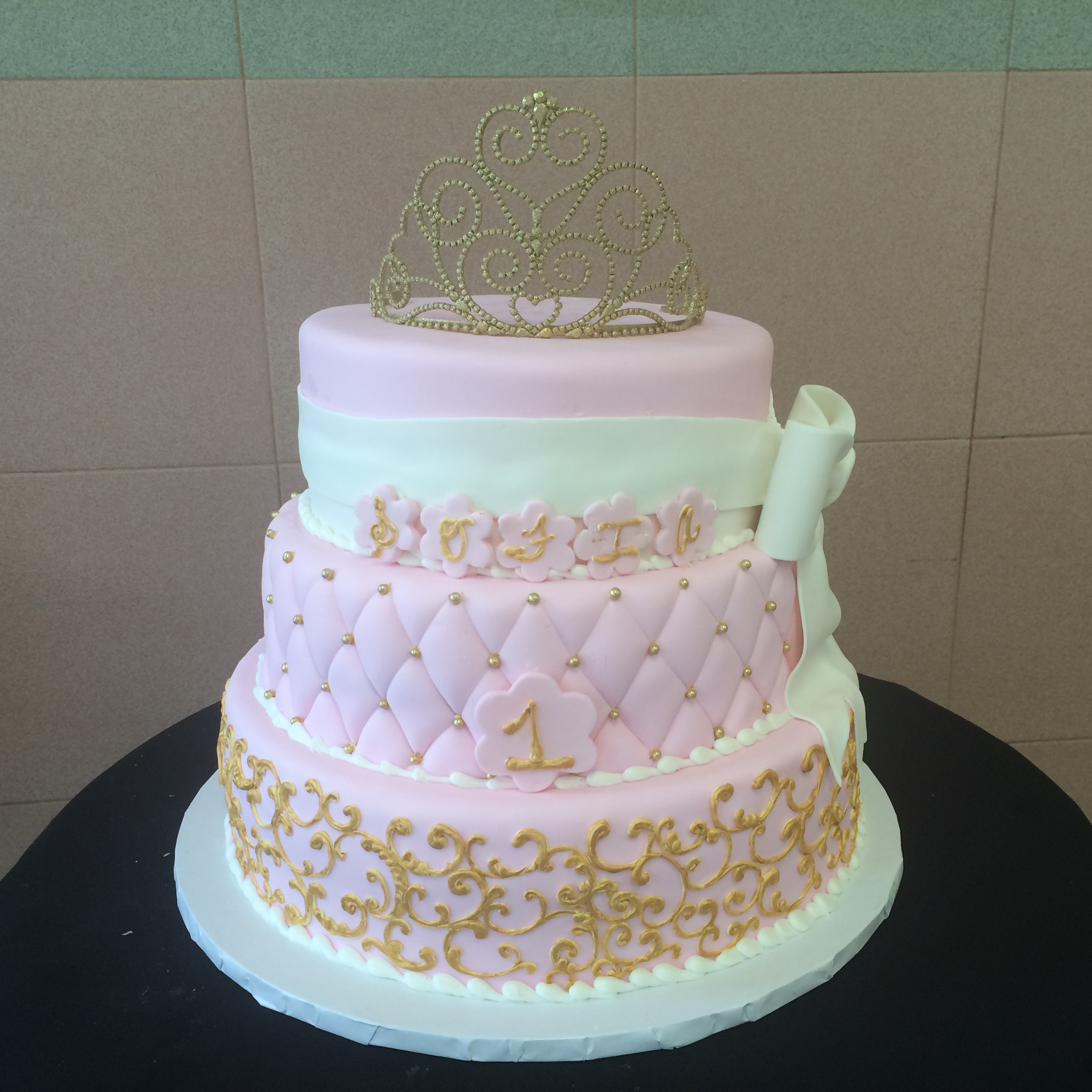 Pink Rolled Fondant. Royal Icing, Hand Painted in Gold, Quilted, White Rolled Fondant Double Ribbon with Bow.jpg