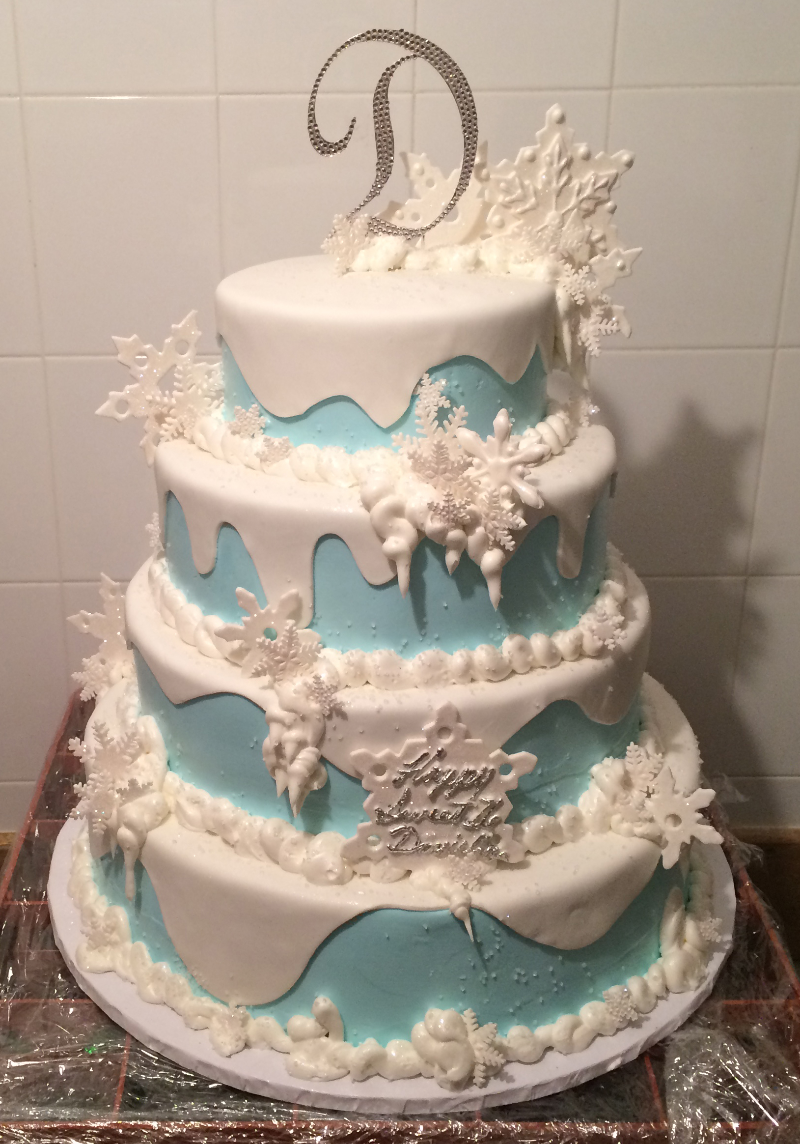Blue butter cream with white rolled fondant & fondant snowflakes.jpg