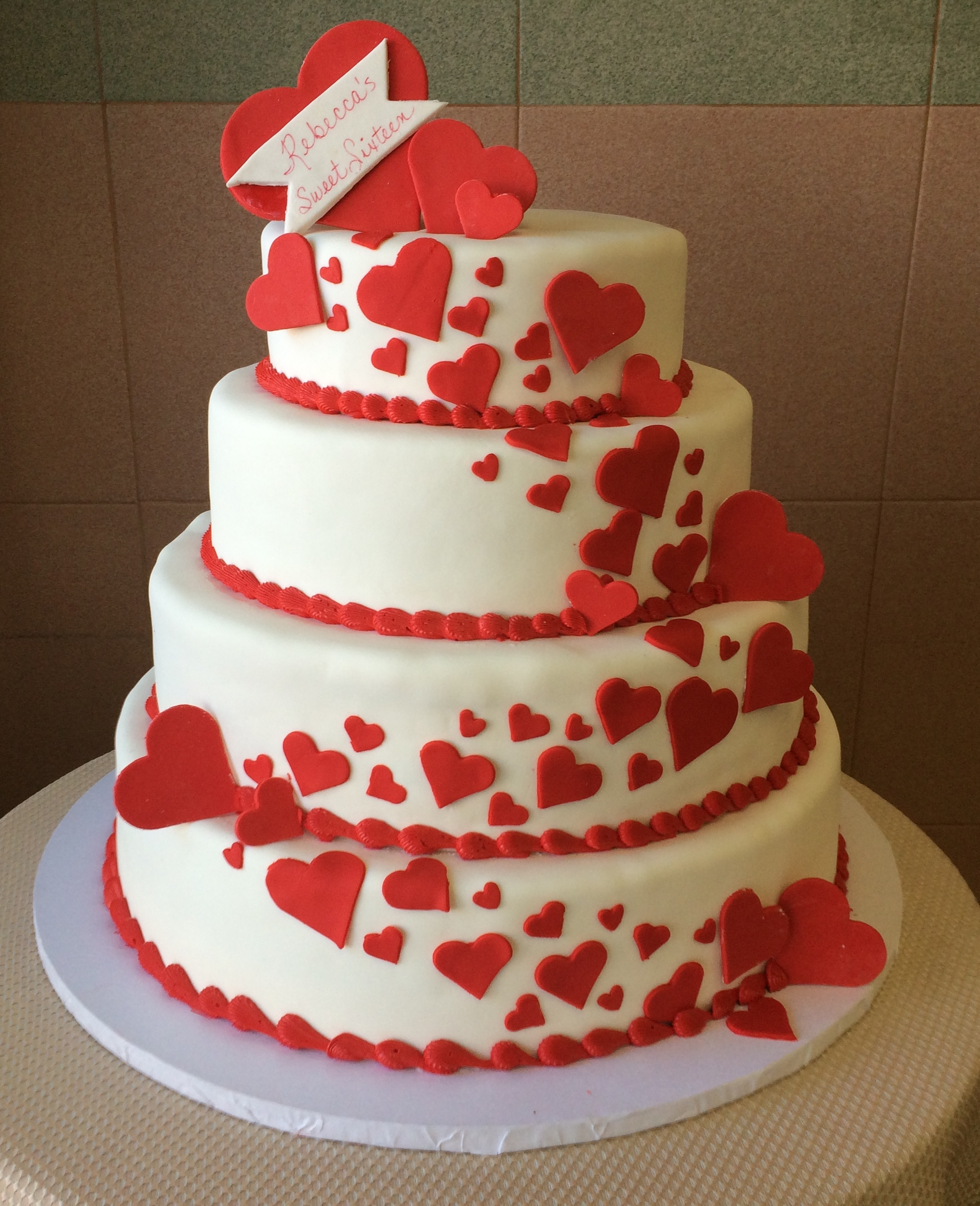 White Rolled Fondant red heart cut outs.jpg