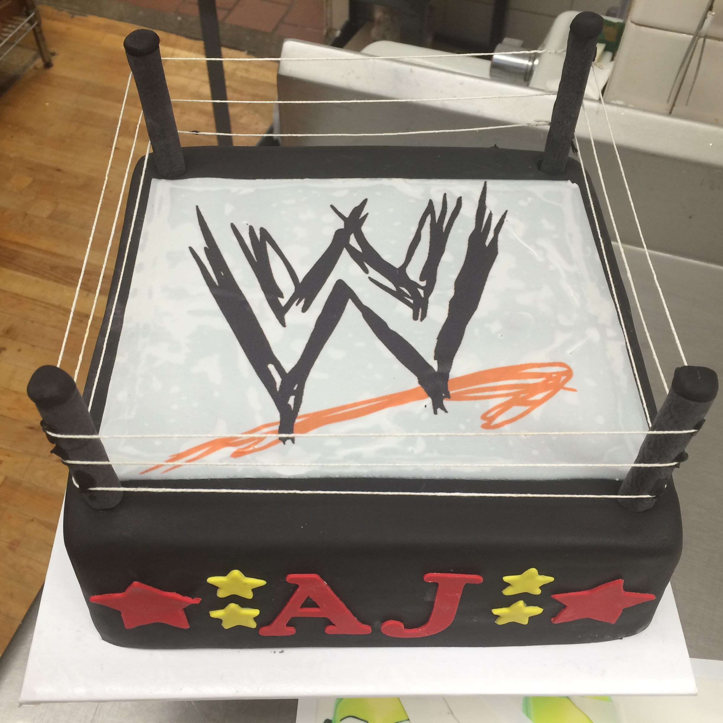 WWE wrestling ring in Rolled Fondant with Letters & Stars around. .jpg