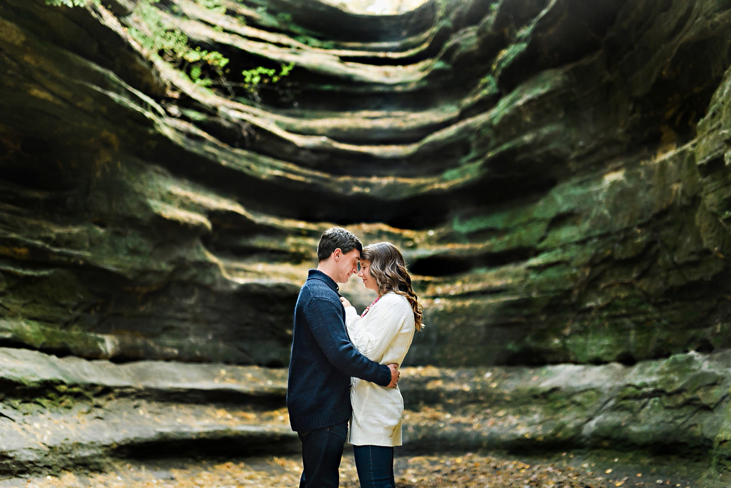 A couple poses candidly for an engagement photo at Starved Rock State Park.