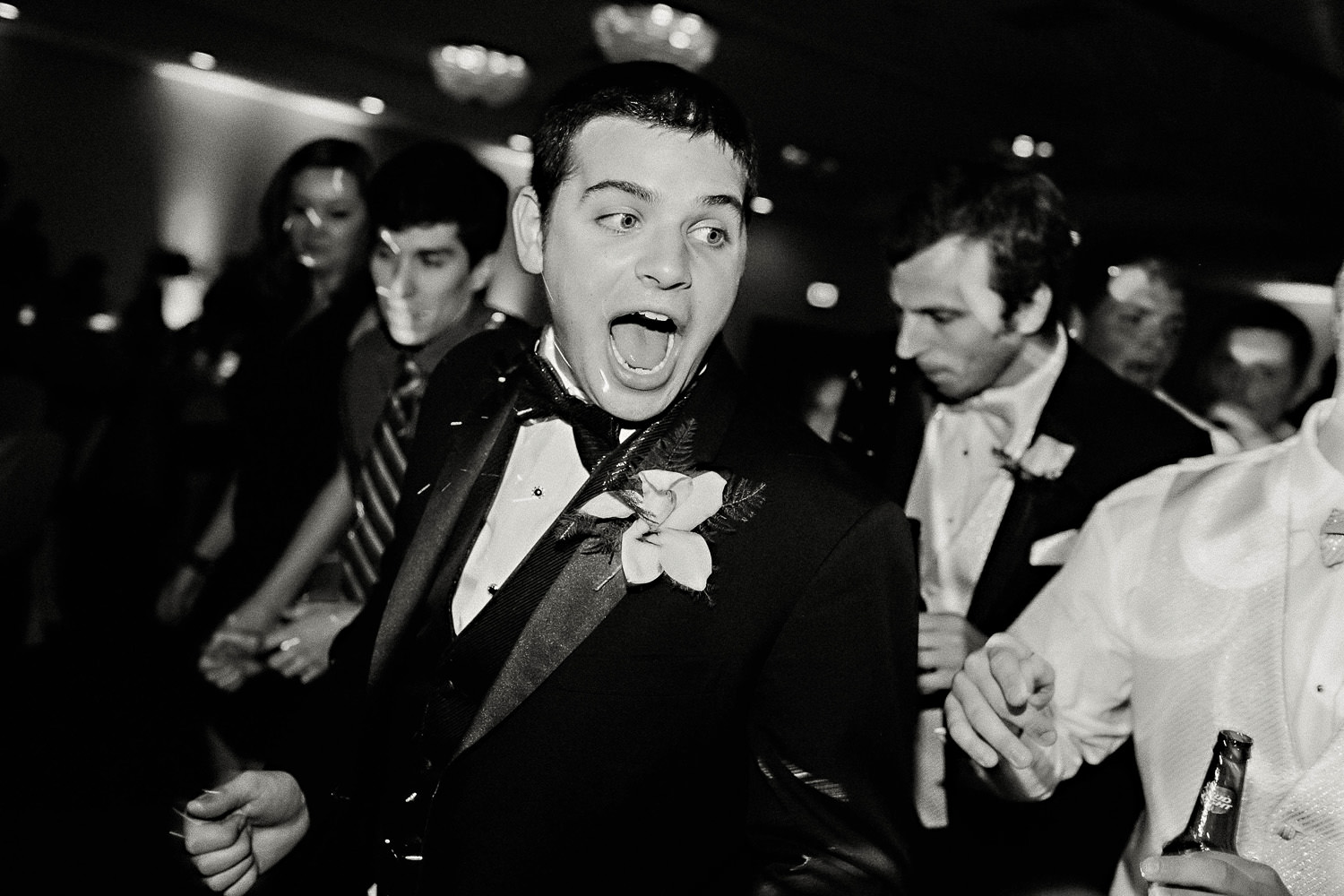 A groom dancing at his reception
