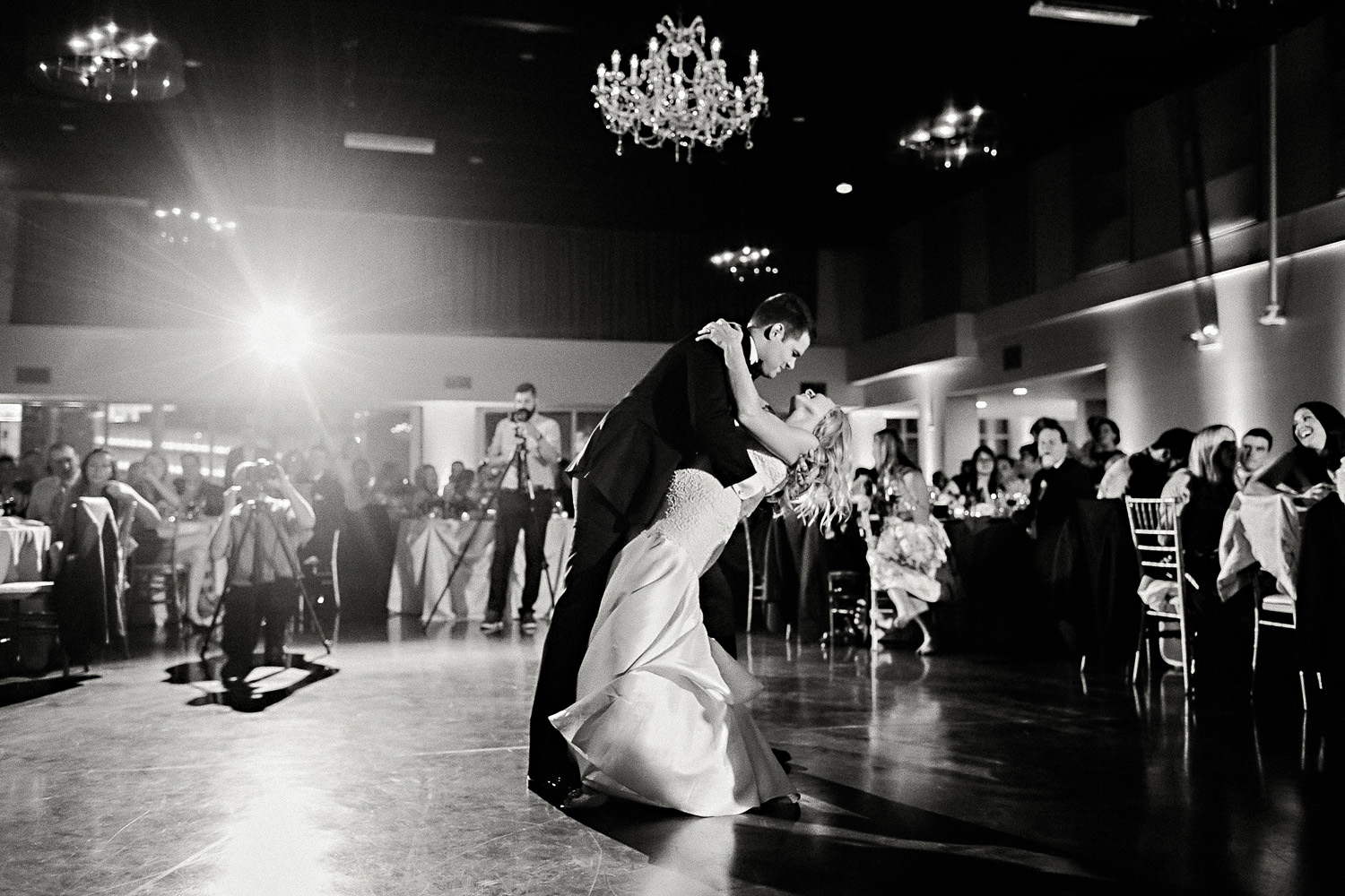 A bride and groom share their first dance.