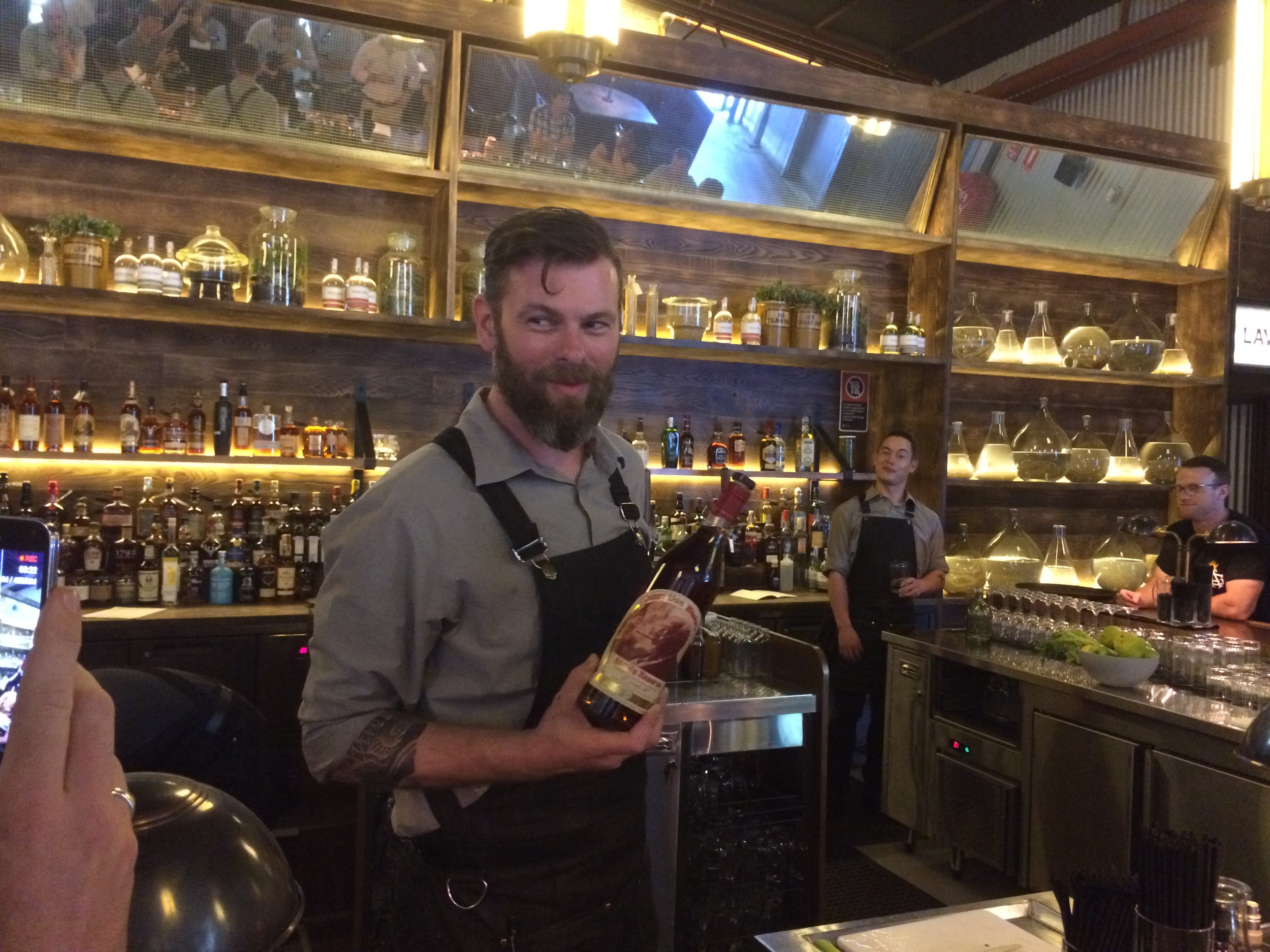 Cameron, Bar Manager for Archie Rose about to pour some Pappy