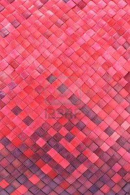 9767092-close-up-of-colored-woven-palm-leaves-mat-background.jpg