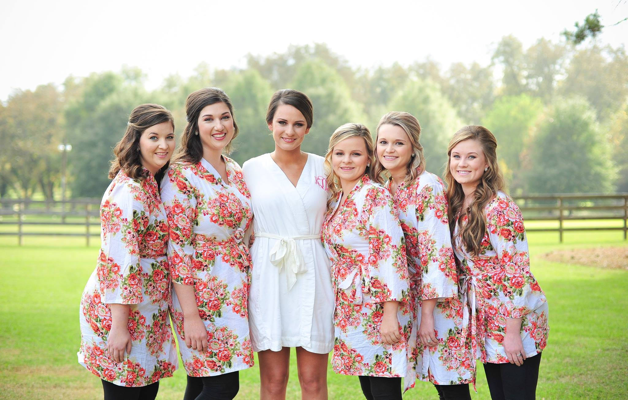 Bridesmaid robes coral floral at Southern Bridle Farms with the beautiful bride.