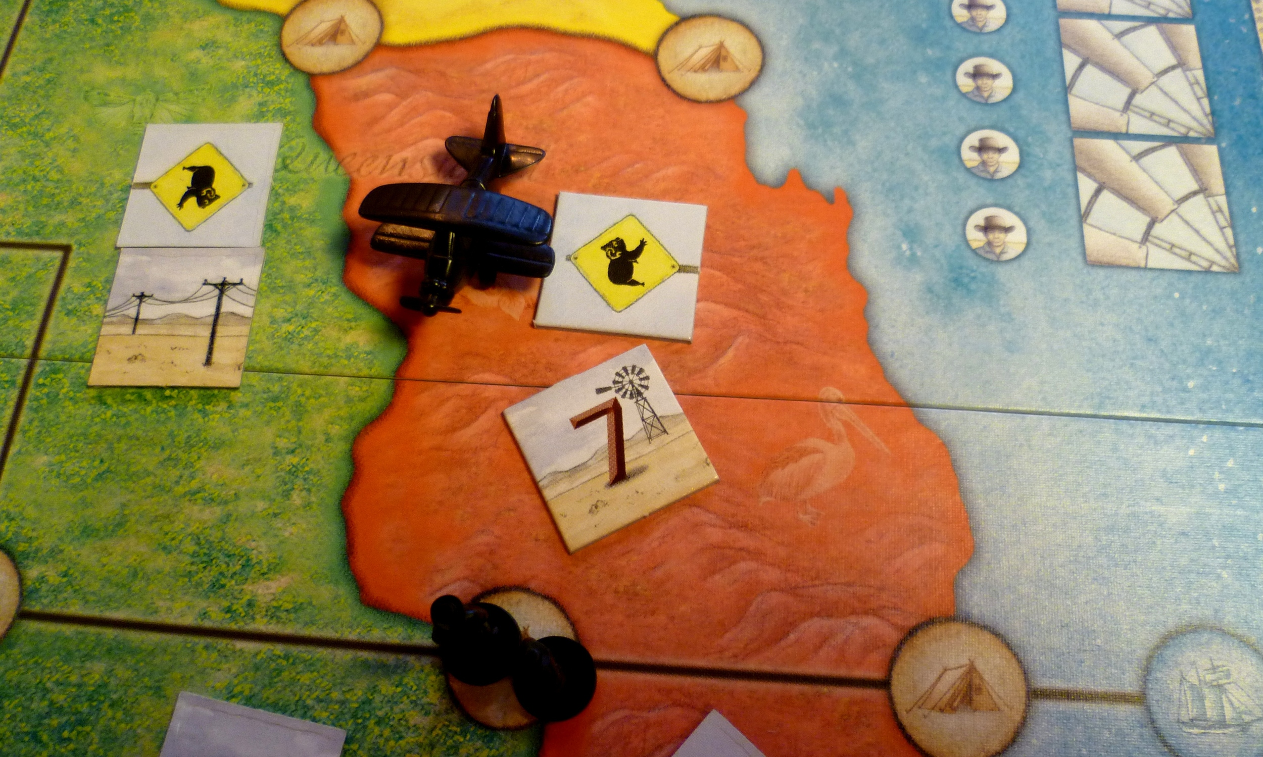 Black has flown toa red territory revealing the industry token and placing 2 men in the South Westerly Camp.