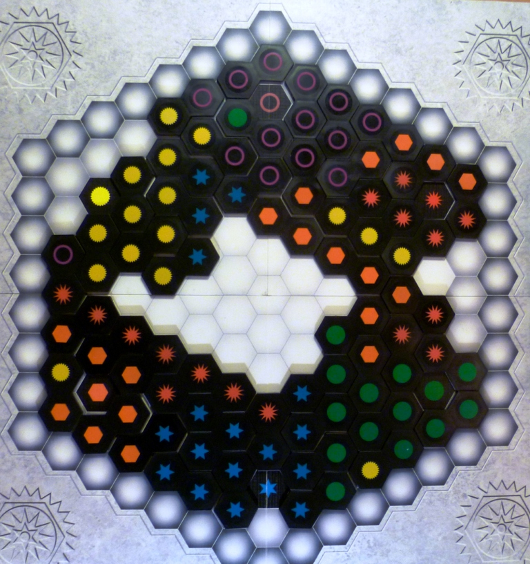 The board showing all the colours of the game, each colour has a unique symbol making this a colour-blind-friendly game