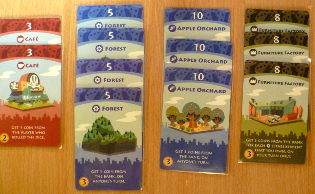 Part layout of cards in Machi Koro, with a roll of 8 this player is looking to gain 36 cash.