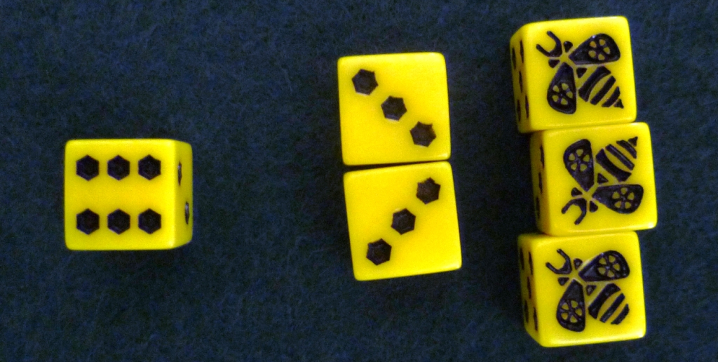 To speed up play it is handy if players set out their dice in numerical order. Note the hexes as dots on the dice - a nice touch to this game.