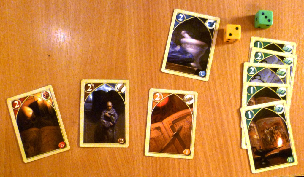 The winning hand in Biblios winning 2 of the dice and 5 points.