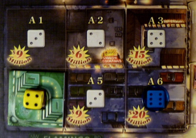 """Lored of Vegas board, with a """"lot"""" owned by Blue on the right, and a 1-tile casino, with Yellow as """"boss"""" on the left."""