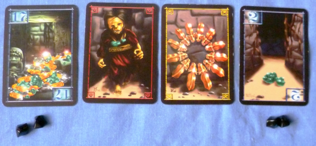 Two treasure cards flanking a disaster card and a special treasure card