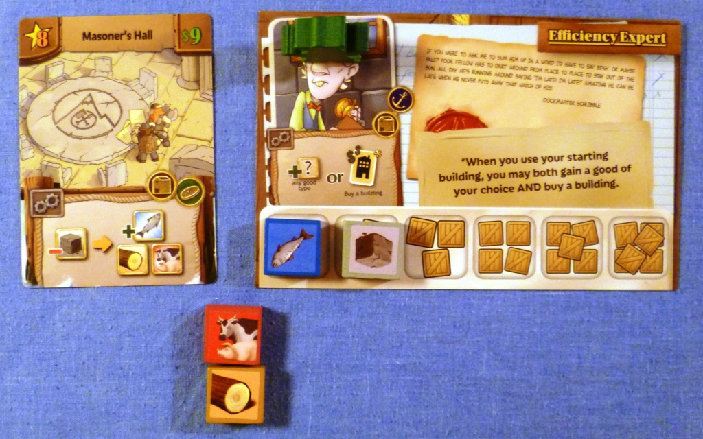 A players position early in the game after purchase of his first building. The large card is the players character with special ability