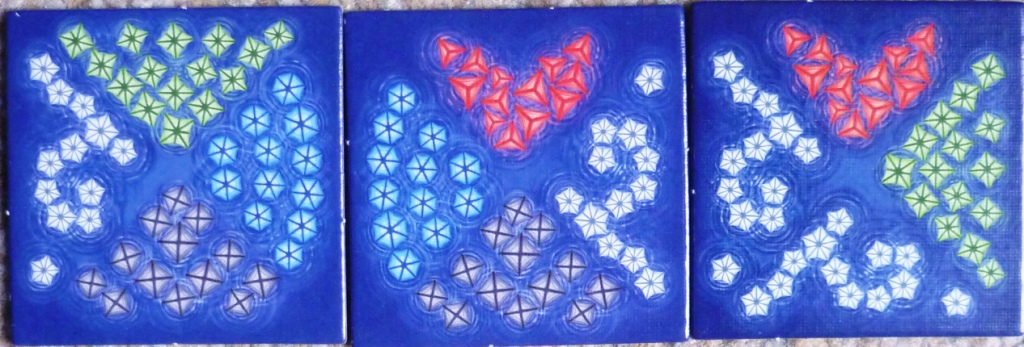 Close up of 3 lantern tiles