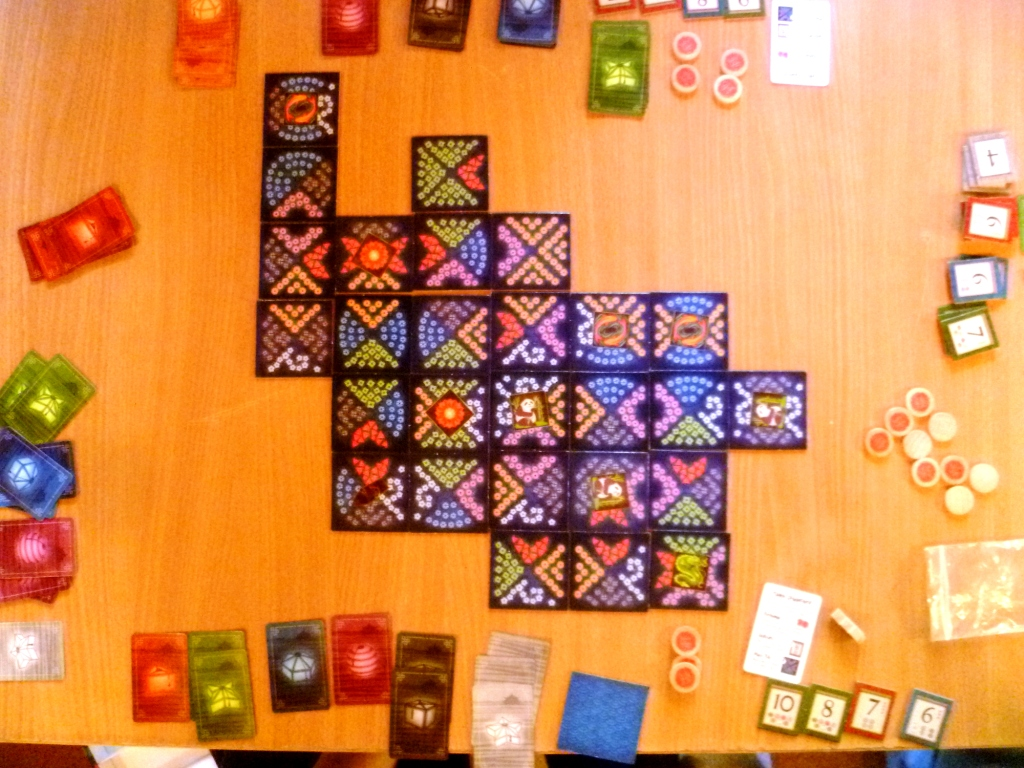 Game of Lanterns part way through, victory point tokens at bottom right