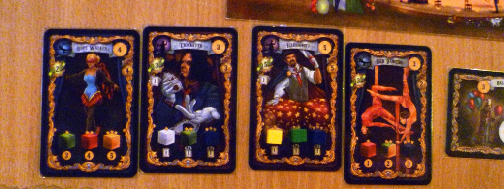 One of the players performers showing the cubes required to fully equip them, the third card has been equipped.