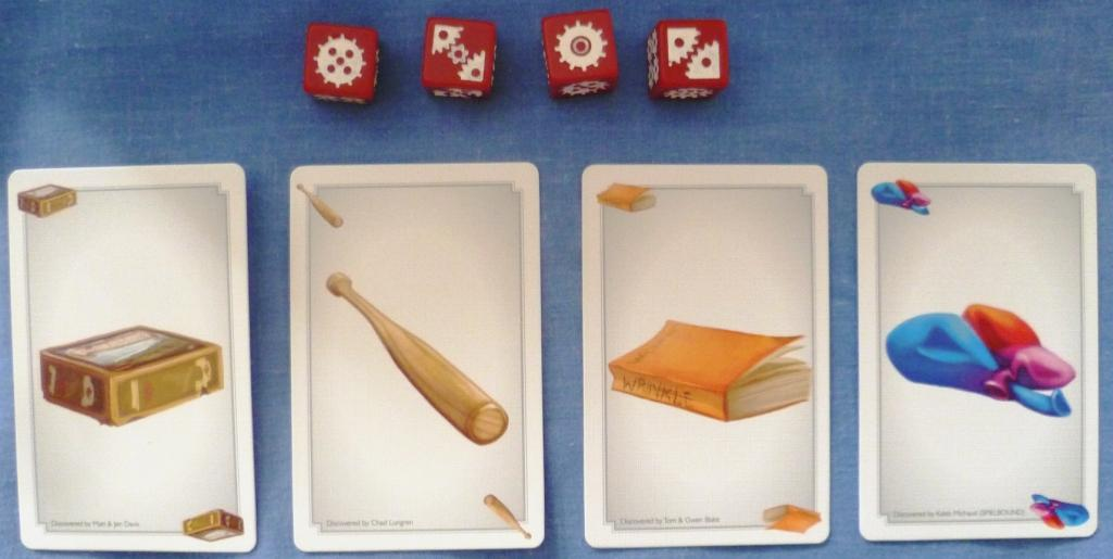 Artifact cards and dice used in Euphoria