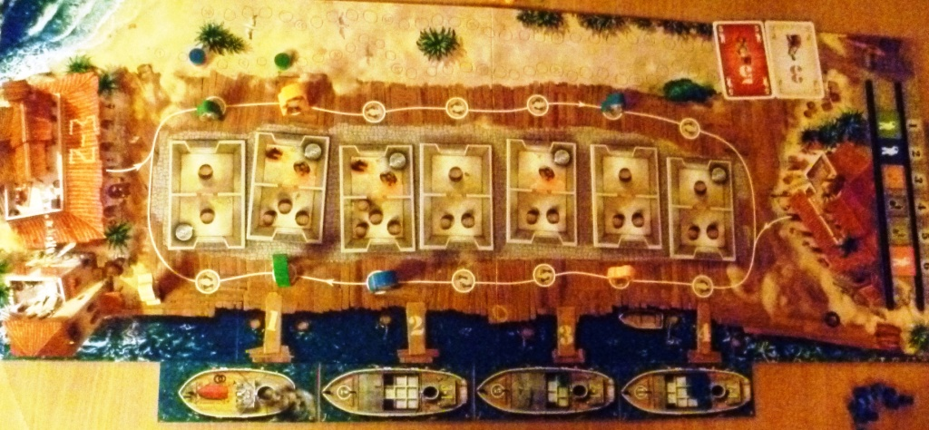 View of the board early in the game, a few deliveries have been made to ships (cubes on boats)