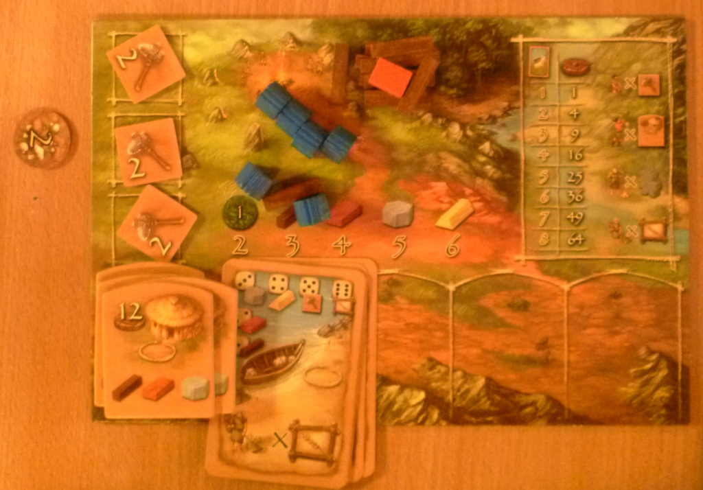 Player board with huts (bottom left) and bonus cards also tools (upper left on board) obtained from a special space on the main board