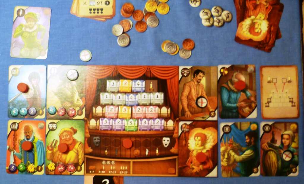 A completed board at the games end, note the dressed stage and the costumed actors (left with discs)