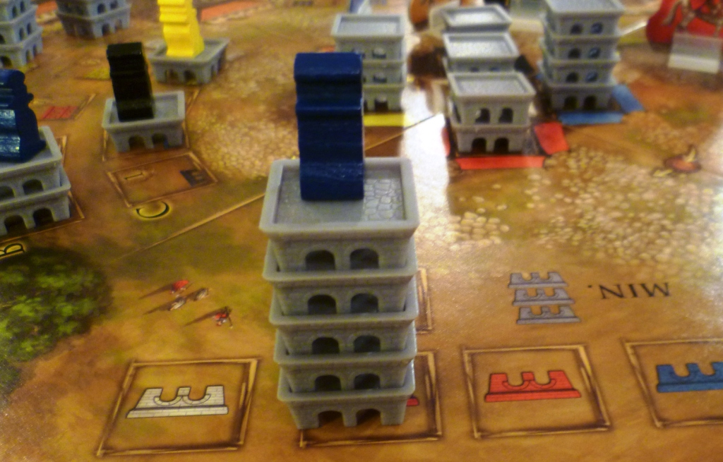 A tower built of red bricks in the Porta Nigra owned by the blue player