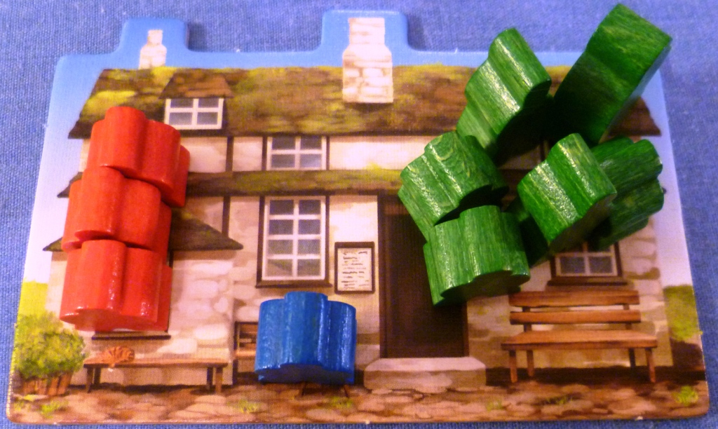 When an area is scored the meeples are sent to the pub where it costs a gold to release them.