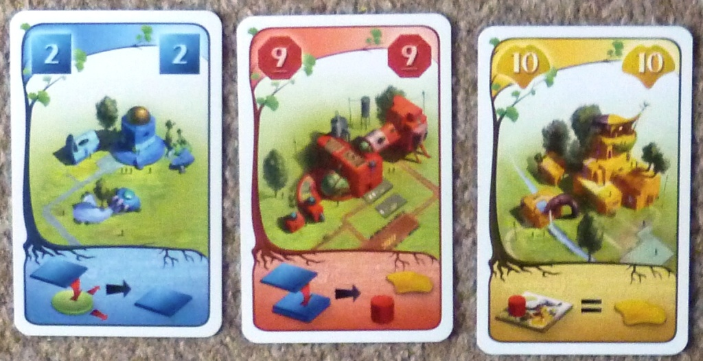 A sample of the cards, the bottom section of a card shows the bonus for that type of action, the right hand card is showing a game end bonus.