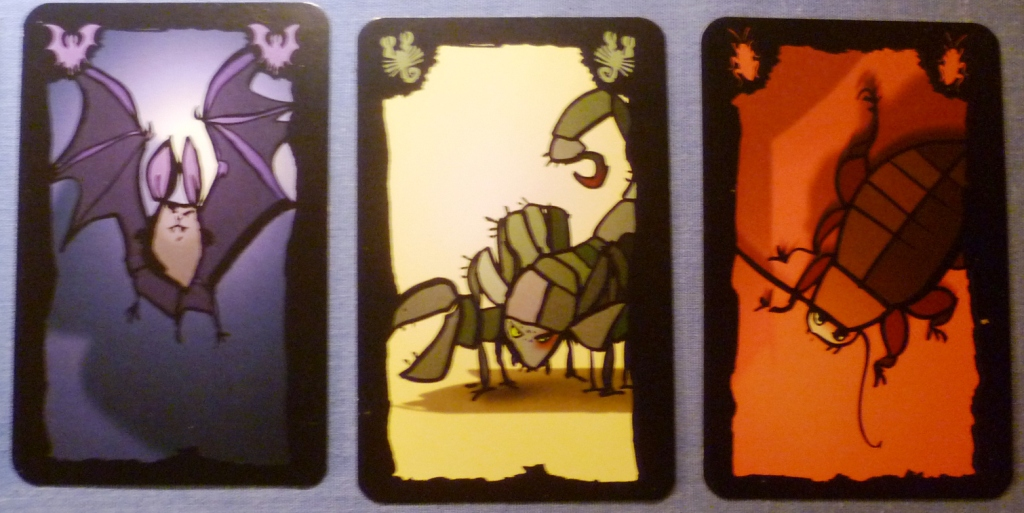 Three of the creatures in Cockroach Poker