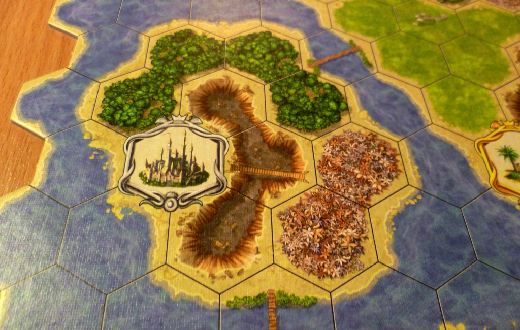 Part of the board showing a 3 point citadel with crags, flowers and a forest nearby