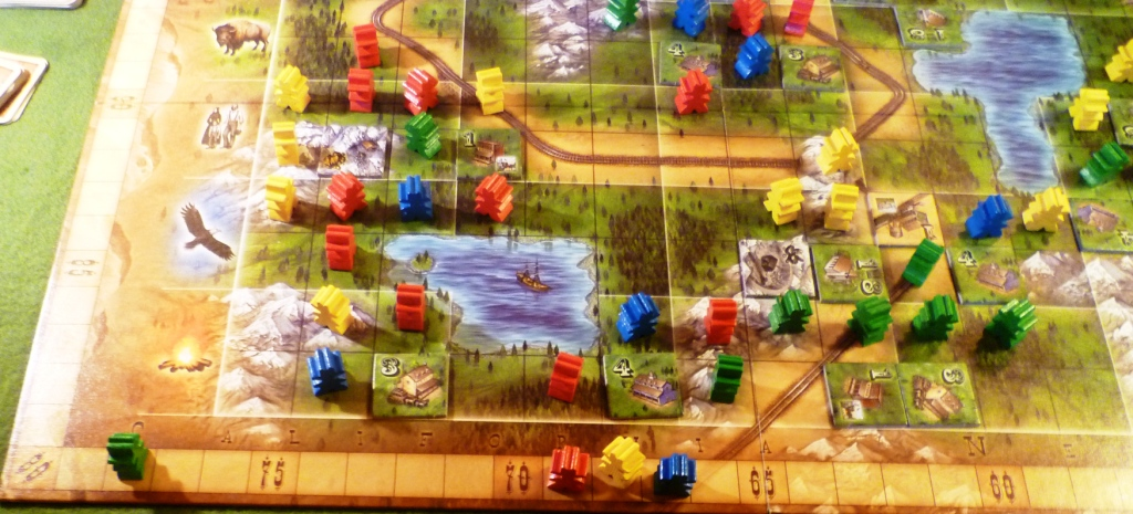 Oregon at the end won by green. The board shows groups of meeples around the buildings.