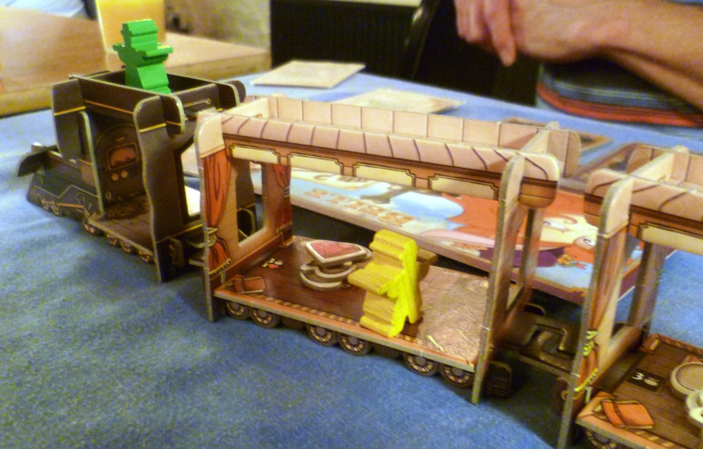 The Marshal near the front of the train guards a gem and some cash bags