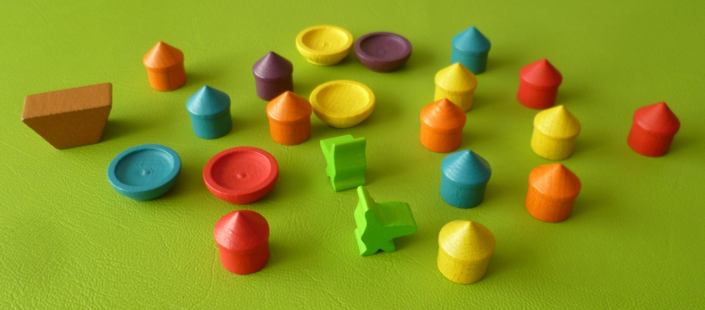 Some of the playing pieces - Huts, bowls, boat and birds