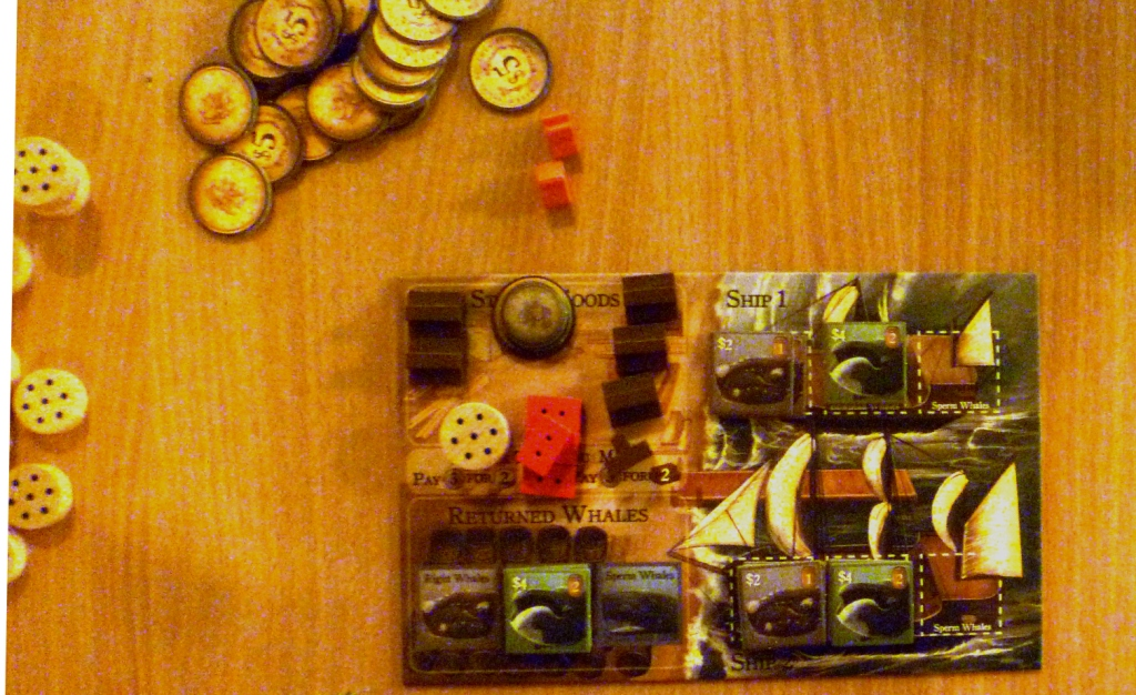 My player board with my few resources, the wales on my 2 ships (stacks on the right of the board) Wales in storage and thus scoring bottom left of the board.