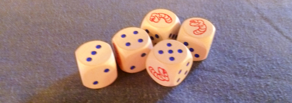 A sample die roll with some of the dice - you have to admit -cute worms (if worms can be cute)