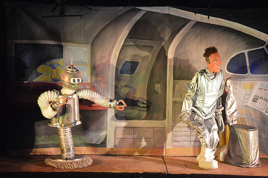 """In the puppet show """"Nick of Time,"""" astronaut Nick Eastman (right) and his """"hoverbot"""" Glitch encounter a deep-space alien and have a wacky time-warp adventure."""