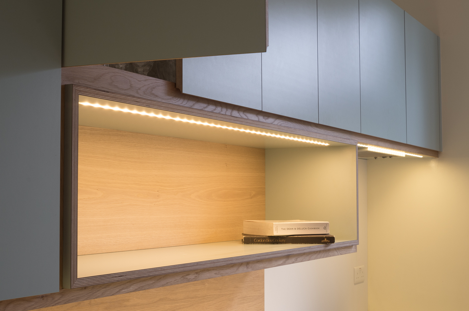 Copy of Bespoke kitchen display area with mitred oak trim.